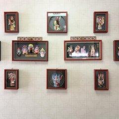 Отель Chinese Culture Holiday Hotel - Nanluoguxiang Китай, Пекин - отзывы, цены и фото номеров - забронировать отель Chinese Culture Holiday Hotel - Nanluoguxiang онлайн интерьер отеля фото 2