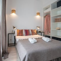 Апартаменты Habitat Apartments Pl. Espana Balconies Барселона сейф в номере