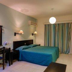 Отель Kefalos Beach Tourist Village сейф в номере