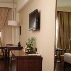 Отель Cambay Grand удобства в номере