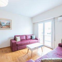 Отель Athens Crown Paradise Apartments Греция, Афины - отзывы, цены и фото номеров - забронировать отель Athens Crown Paradise Apartments онлайн комната для гостей