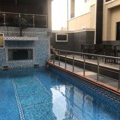 Отель Ritz-Carinton Suites Нигерия, Энугу - отзывы, цены и фото номеров - забронировать отель Ritz-Carinton Suites онлайн бассейн