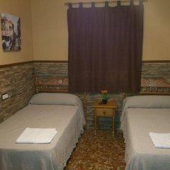 Отель Pension Los Faroles Испания, Фуэнхирола - отзывы, цены и фото номеров - забронировать отель Pension Los Faroles онлайн комната для гостей