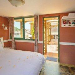 Отель Xiamen Gulangyu Sunshine Dora's House Китай, Сямынь - отзывы, цены и фото номеров - забронировать отель Xiamen Gulangyu Sunshine Dora's House онлайн комната для гостей фото 2