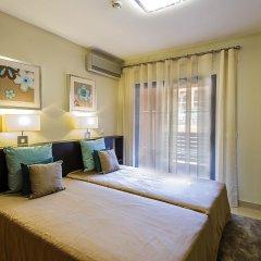 Апартаменты Amendoeira Golf Resort - Apartments and villas комната для гостей