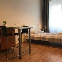 Апартаменты Slavojova ApartMeet комната для гостей фото 4