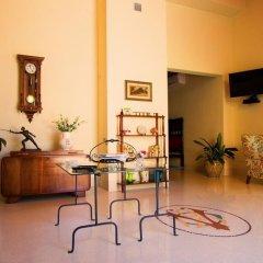 Отель L'Altra Metà Италия, Гальяно дель Капо - отзывы, цены и фото номеров - забронировать отель L'Altra Metà онлайн удобства в номере