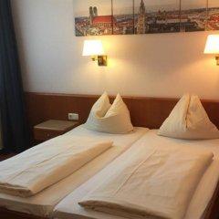 Отель Carmen Германия, Мюнхен - 9 отзывов об отеле, цены и фото номеров - забронировать отель Carmen онлайн комната для гостей фото 2