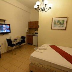 Апартаменты Loui M Apartments Хайфа комната для гостей фото 4