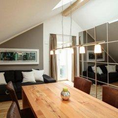 Апартаменты Paleo Finest Serviced Apartments Мюнхен комната для гостей фото 2