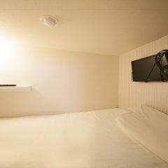 Отель Capsule and Sauna Oriental Япония, Токио - отзывы, цены и фото номеров - забронировать отель Capsule and Sauna Oriental онлайн комната для гостей фото 3