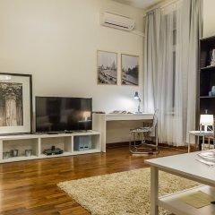 Апартаменты GM Apartment Serafimovicha 2 Москва комната для гостей фото 5