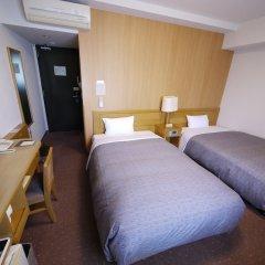 Отель Route-Inn Oita Ekimae Ойта сейф в номере