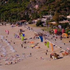 Akdeniz Beach Hotel Турция, Олюдениз - 1 отзыв об отеле, цены и фото номеров - забронировать отель Akdeniz Beach Hotel онлайн пляж фото 2