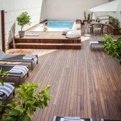 Отель Eric Vökel Boutique Apartments - Atocha Suites Испания, Мадрид - отзывы, цены и фото номеров - забронировать отель Eric Vökel Boutique Apartments - Atocha Suites онлайн бассейн фото 3