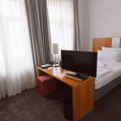 Отель Astor & Aparthotel Германия, Кёльн - отзывы, цены и фото номеров - забронировать отель Astor & Aparthotel онлайн удобства в номере фото 2