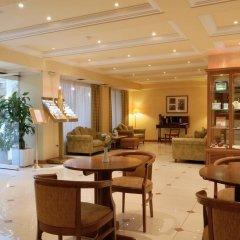 Отель Athens Atrium Hotel and Suites Греция, Афины - 2 отзыва об отеле, цены и фото номеров - забронировать отель Athens Atrium Hotel and Suites онлайн интерьер отеля фото 2