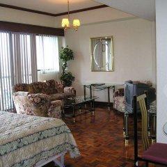 Отель Citadel Inn Makati Филиппины, Макати - отзывы, цены и фото номеров - забронировать отель Citadel Inn Makati онлайн комната для гостей фото 2