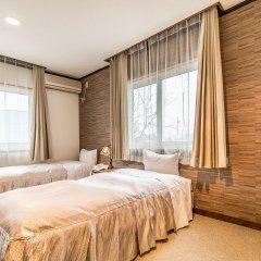 Petit Hotel Enchante Хакуба комната для гостей