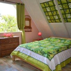 Отель Maison Te Vini Holiday home 3 Французская Полинезия, Пунаауиа - отзывы, цены и фото номеров - забронировать отель Maison Te Vini Holiday home 3 онлайн комната для гостей фото 2