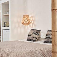 Отель Naxian Utopia Luxury Villas & Suites сейф в номере