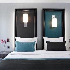 Отель Bassano Франция, Париж - отзывы, цены и фото номеров - забронировать отель Bassano онлайн комната для гостей фото 3