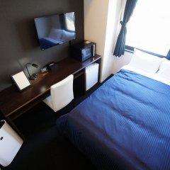 Hotel Livemax Tokyo Shiomi Ekimae сейф в номере