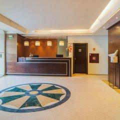 Отель NH Lisboa Campo Grande интерьер отеля