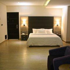 Отель Scarlet Lodge Нигерия, Лагос - отзывы, цены и фото номеров - забронировать отель Scarlet Lodge онлайн сейф в номере