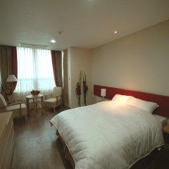 Отель Ramada Hotel and Suites Seoul Namdaemun Южная Корея, Сеул - 1 отзыв об отеле, цены и фото номеров - забронировать отель Ramada Hotel and Suites Seoul Namdaemun онлайн комната для гостей