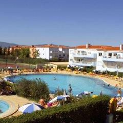 Отель Oasis Parque Country Club Портимао бассейн
