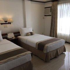 Отель Soledad Suites Филиппины, Тагбиларан - отзывы, цены и фото номеров - забронировать отель Soledad Suites онлайн комната для гостей