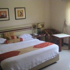Отель AXARI Калабар комната для гостей