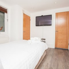 Отель Beautiful 4 Bedroom House in South Kensington комната для гостей