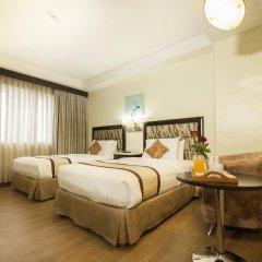 Отель Diamond Suites And Residences Филиппины, Лапу-Лапу - 1 отзыв об отеле, цены и фото номеров - забронировать отель Diamond Suites And Residences онлайн комната для гостей фото 5