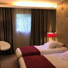 Отель Privilège Hôtel Mermoz Франция, Тулуза - отзывы, цены и фото номеров - забронировать отель Privilège Hôtel Mermoz онлайн комната для гостей фото 4