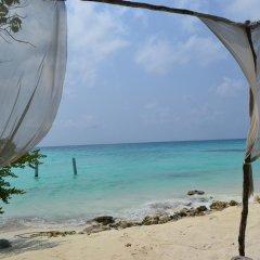 Отель Maison Tiare' Maldives Thulusdhoo Остров Гасфинолу пляж
