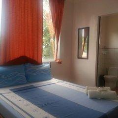 Отель Seasons Guesthouse Филиппины, Пуэрто-Принцеса - отзывы, цены и фото номеров - забронировать отель Seasons Guesthouse онлайн комната для гостей фото 5