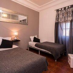Отель V Dinastia Lisbon Guesthouse комната для гостей