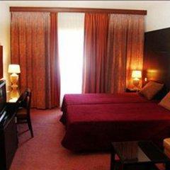 Отель Canadiano - Urban Nature Hotel Португалия, Понта-Делгада - отзывы, цены и фото номеров - забронировать отель Canadiano - Urban Nature Hotel онлайн комната для гостей фото 4