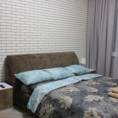 Апартаменты SKY-APARTMENTS комната для гостей фото 5