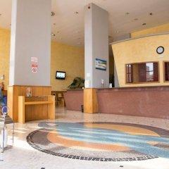 Отель Clube Praia Mar Португалия, Портимао - отзывы, цены и фото номеров - забронировать отель Clube Praia Mar онлайн интерьер отеля