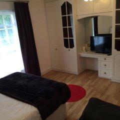Апартаменты Wellington Road Apartments комната для гостей