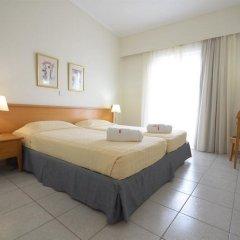 Отель Kos Hotel Junior Suites Греция, Кос - отзывы, цены и фото номеров - забронировать отель Kos Hotel Junior Suites онлайн комната для гостей фото 4