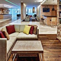 Отель Hilton Garden Inn Davos Швейцария, Давос - отзывы, цены и фото номеров - забронировать отель Hilton Garden Inn Davos онлайн интерьер отеля