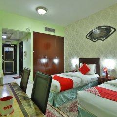 OYO 261 Remas Hotel Apartment Дубай комната для гостей фото 5