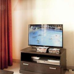 Отель Apartamentos Fomento 25 Испания, Мадрид - отзывы, цены и фото номеров - забронировать отель Apartamentos Fomento 25 онлайн удобства в номере фото 2