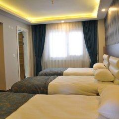 Отель Madi Otel Izmir комната для гостей фото 5