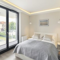 Апартаменты Luxury Apartments - Okrzei Residence Сопот комната для гостей фото 3