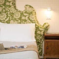 Отель Tritone 125 удобства в номере